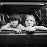 Best photographer in Toronto Ian Taylor. Two children in a car.